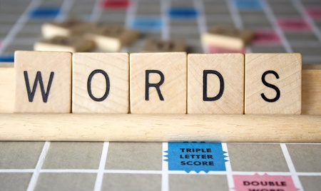 Words is spelled out using lettered wood tiles Stock Photo