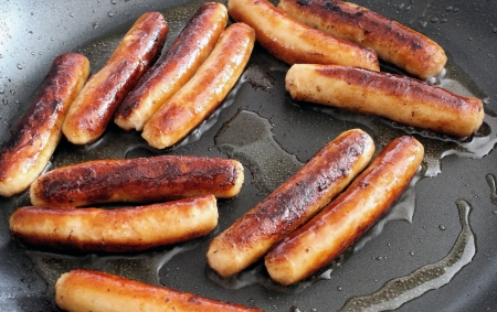 Sausages Frying In A Skillet photo