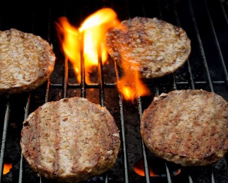Burgers Sizzling On The Grill photo