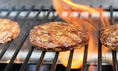 sizzling: Juicy Burgers Sizzling On The Grill