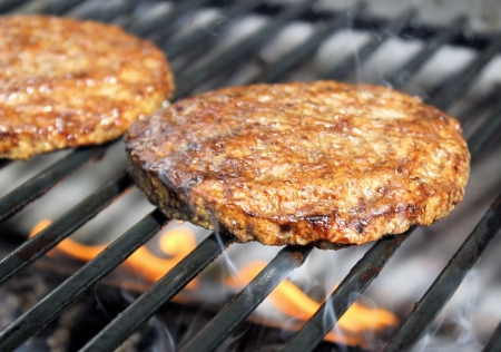Juicy Burgers Sizzling On The Grill photo