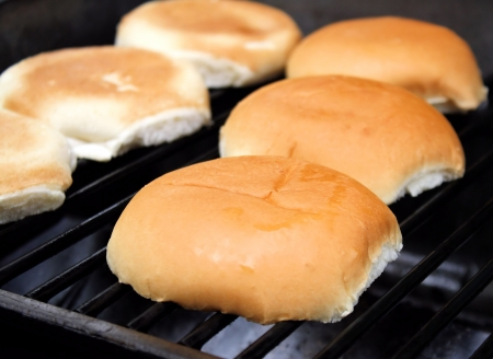 griddle: Hamburger Buns Toasting On The Grill