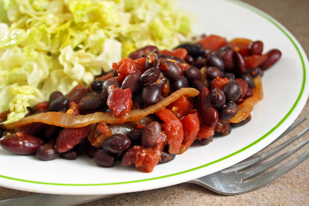 Nutritious vegetarian chili with a fresh garden salad photo