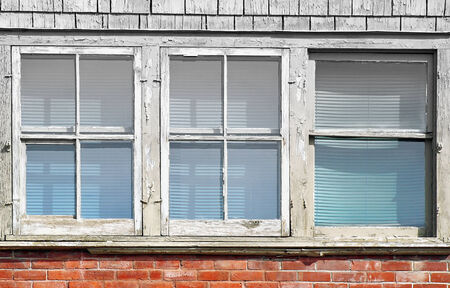 panes: Old weathered windows on exterior of building Stock Photo