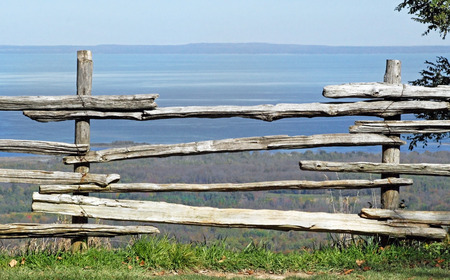 fencing wire: Weathered wood fencing at edge of cliff with beautiful scenic view beyond Stock Photo