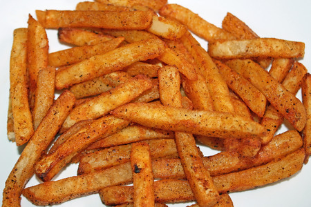 Oven Baked Spicy Fries Фото со стока