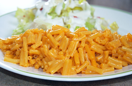 side salad: Plate of Macaroni and Cheese with a side salad - a quick and easy meal