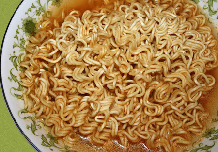 Bowl of Spicy Ramen noodles in broth