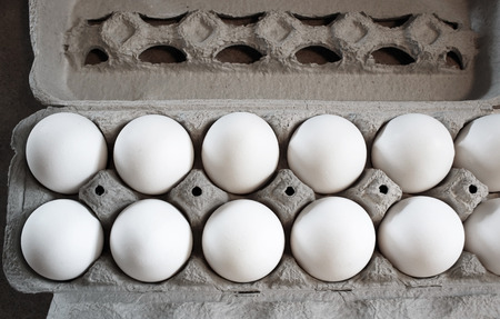 Carton of Wholesome and nutritious Organic white eggs Stock Photo