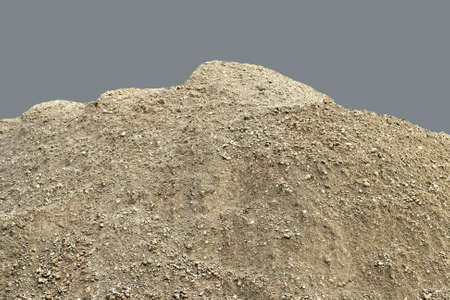 dirt pile: Pile of natural unsifted dirt with small pebbles and stones embedded  isolated on a blue background Stock Photo