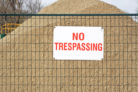 trespassing: NO TRESPASSING sign at construction site
