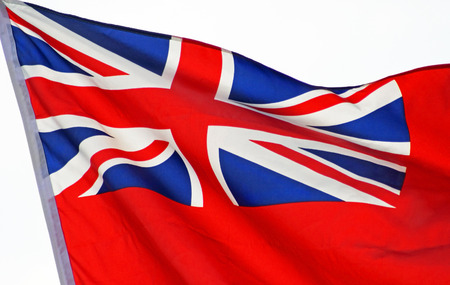 proudly: Union Jack flag waving proudly in the breeze