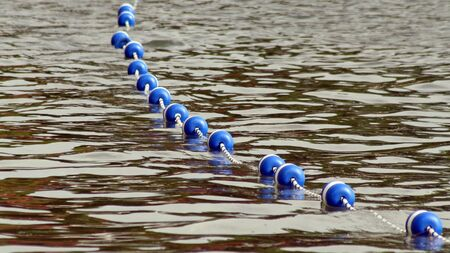floater: Buoys strung together by rope along lake to create safe swimming area for swimmers