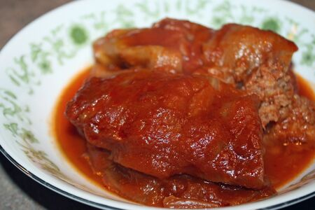 tangy: Bowl of Homemade Cabbage Rolls in a tangy Tomato Sauce
