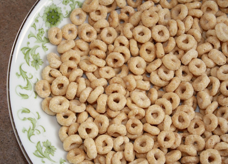 cereal bowl: Dry wholegrain cheerios in a cereal bowl Stock Photo