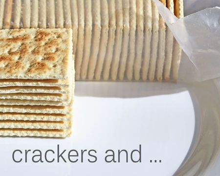 Stack of crispy soda crackers on plate to be enjoyed plain or with a topping Stock Photo