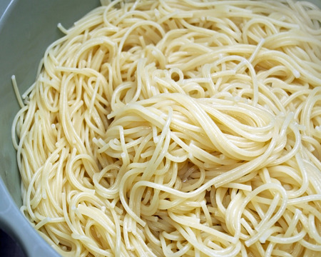 drained: Cooked and drained spaghetti noodles in Colander