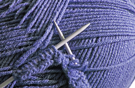 stitches: Knitting needles with knitted stitches using blue wool