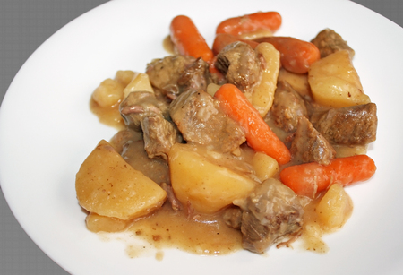 Plate of delicious homemade beef stew.  With beef, carrots and potatoes