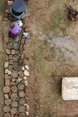 Berilo, Minas Gerais, Brazil - January 21, 2016: Aerial view of a housewife of poor family working in a quilombo area of Brazil 報道画像