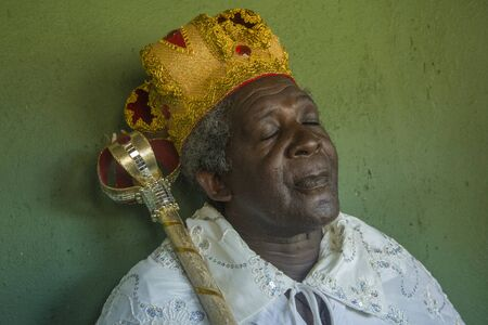 Gonçalves, Minas Gerais, Brazil - March 19, 2016: Afro-Brazilian man in costume, celebrating the Revelry of Kings during carnival Éditoriale