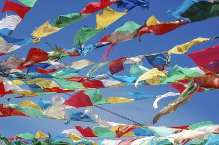 Colorful Tibetan flags fluttering in the wind in Lhasa, Tibet