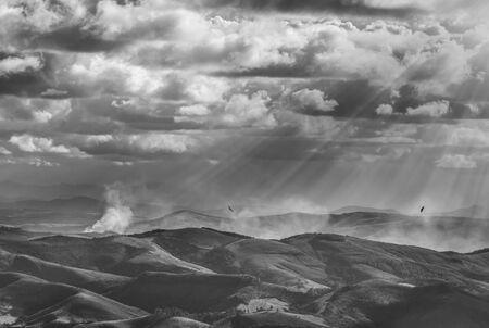 Divine light shining over the vast mountainous fields of the dazzling Ibitipoca State Park, Minas Gerais, Brazil