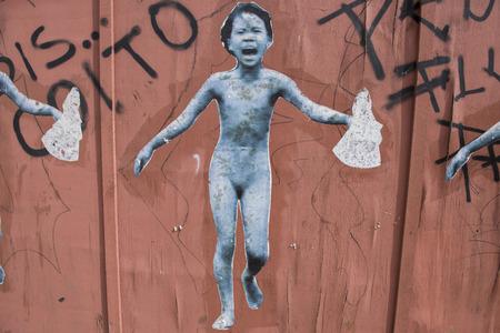 Sao Luis do Maranhao, Maranhao, Brazil - May 19, 2016: Collage street art with the Vietnam War symbolic image of the little girl Kim Phuc running - photo made by Nick Ut in 1972