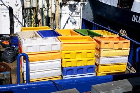 trawler: boxes for fish on trawler sea ocean
