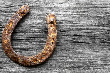 prosper: vintage rusted horseshoe on wall above door