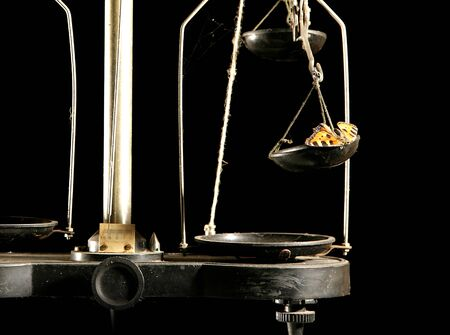 weighting: vintage scales weighting machine with beautiful butterfly on cup isolated on black background