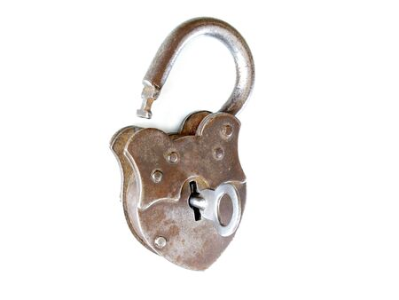 unchained: Unlocked vintage padlock with key in keyhole isolated on white