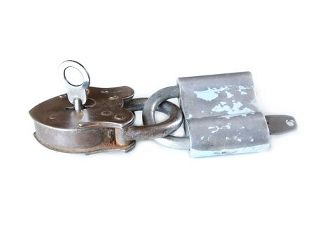 door lock love: together locked vintage padlocks isolated on white background doing teamwork and counting on each other