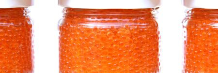 gastronome: trout and salmon red caviar in glass jars on white background