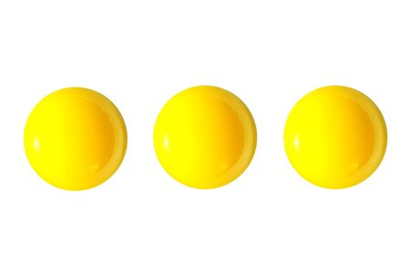 yello: three raw shining yello eggs yolks isolated on white background