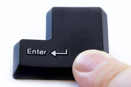 go inside: computer enter key with finger pressing button on white background