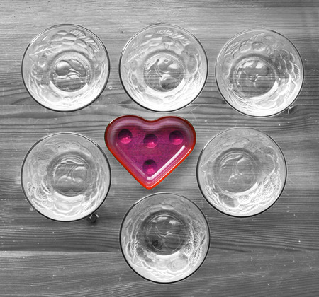 multiple personality: kitchen dishes on  board with one heart shape standing out from the crowd Stock Photo