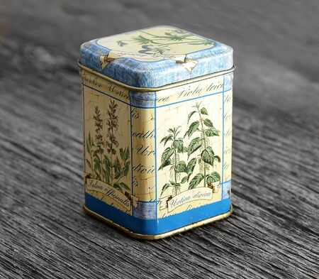 herbs boxes: vintage rusted spices box on board background Stock Photo