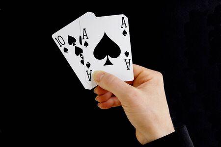 ten best: hand holding best classic winning blackjack combination ten and ace of spades