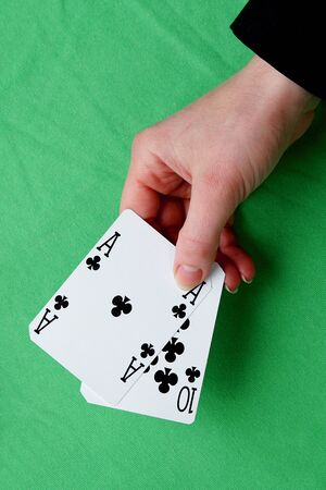 ten best: hand holding best classic winning blackjack combination ten and ace of clubs