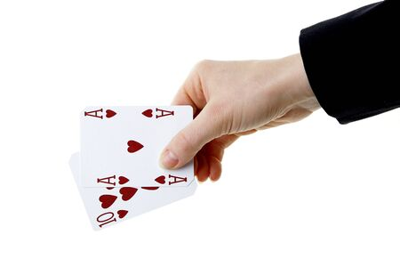 ten best: hand holding best classic winning blackjack combination ten and ace of hearts Stock Photo
