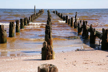 and the stakes: very old vintage stakes in baltic sea