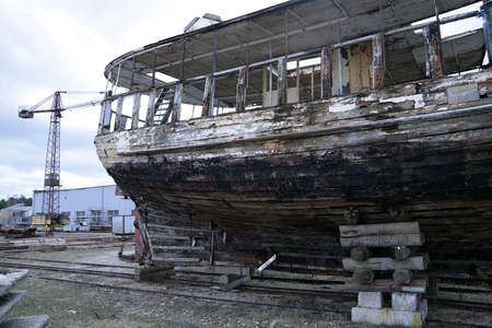 reconstruction: old wooden fishing ship on reconstruction in docks tail