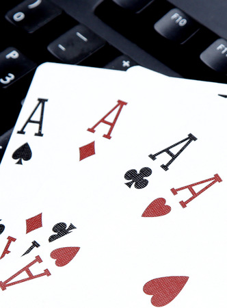 four of a kind: internet casino poker four of kind aces cards comdination hearts on keyboard