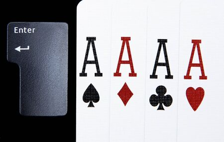 unstoppable: internet casino poker four of kind aces cards comdination hearts with isolated enter key Stock Photo