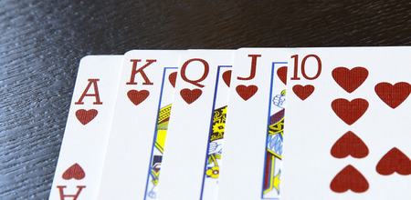 royal flush: internet casino poker royal flush cards comdination hearts on table Stock Photo