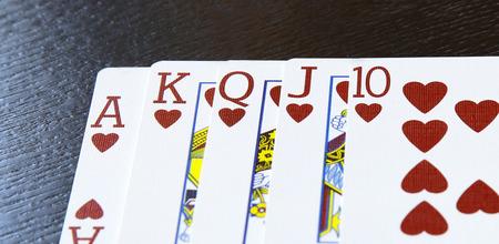 unstoppable: internet casino poker royal flush cards comdination hearts on table Stock Photo