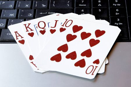 flush: internet casino poker royal flush cards comdination hearts on keyboard Stock Photo