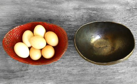 dont put all eggs in one basket proverb representing two trays with eggs not shared Stock Photo