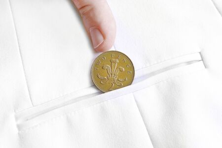 saved penny is penny earned proverb representing coin in jacket pocket